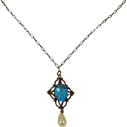 Victorian Lavaliere Necklace with Scrollwork Pendant Accented with Aqua Blue Faceted Oval and Faux Pearl Drop