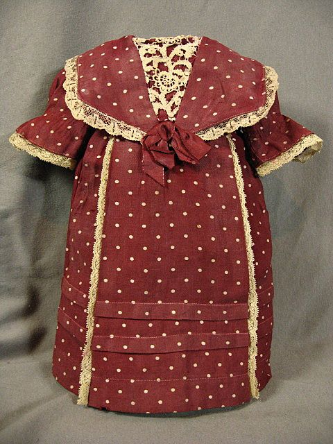Adorable early maroon dress with poka dots