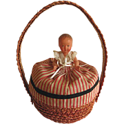 Rare antique French doll basket with celluloid doll