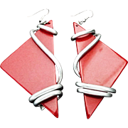 VINTAGE LARGE Art Moderne Red Lucite dangle earrings wrapped in silver tone coils.