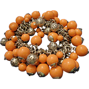 VINTAGE Coral Lucite and filigree silver tone bead stretch bracelet
