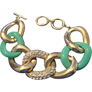 VINTAGE Large gold tone and aqua lucite link bracelet with rhinestones and toggle