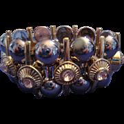 VINTAGE UNIQUE Modernist Wide Gold and silver tone stretch bracelet