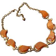 VINTAGE Fabulous peach Moon glow Lucite/thermoset Necklace in gold tone