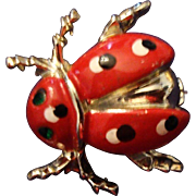VINTAGE Adorable Lady Bug pin in red enamel with black and white polka dots.