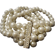 VINTAGE 4 Strand stretch 8mm pearl bracelet with rhinestone center