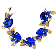 VINTAGE Cluster necklace with sapphire lucite cabochons on gold tone leaves