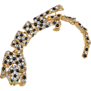 VINTAGE Gold tone leopard articulated brooch with jet black enamel spots and clear rhinestones