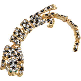 VINTAGE Gold tone leopard articulated brooch with jet black and clear rhinestones