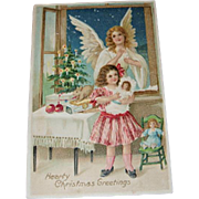 Christmas Postcard of Angel, Child Holding Doll