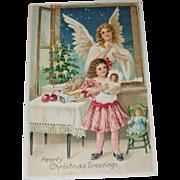 Christmas Postcard of Angel, Child Holding Doll
