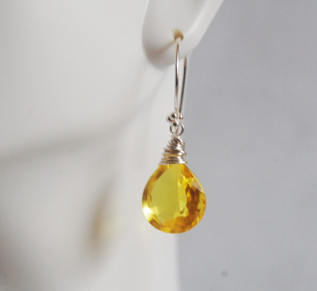 Yellow sapphire earrings are most often crafted in white or yellow gold or platinum but silver is also an option if budget is a concern. Because the color of your yellow sapphire earrings will catch the eye, you will want to closely match the color of a yellow sapphire necklace or yellow sapphire ring.