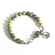 Reserve listing For Daniel--  Russian Obsidian  and Yellow serpentine  Bracelet