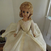 Hard Plastic Doll With White Gown