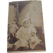 Early 1900's Picture of Baby With Dolls and Stuffed Dog