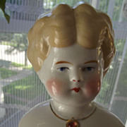 Blonde China Doll With Necklace