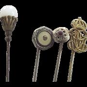 Four Old Stickpins