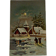 Victorian/Edwardian Christmas Postcard With Night Scene of a House and Church With Pine trees and Two People