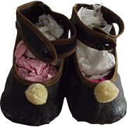 Black Toddler Shoes With Brown Trim and Pom Poms