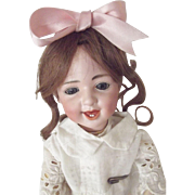 Gebruder Heubach Smiling and Dimpled Character Doll As Is, sleep blue eyes, good body with repair to one knee.
