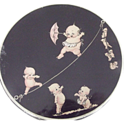 Tin With Kewpies On A Tightrope