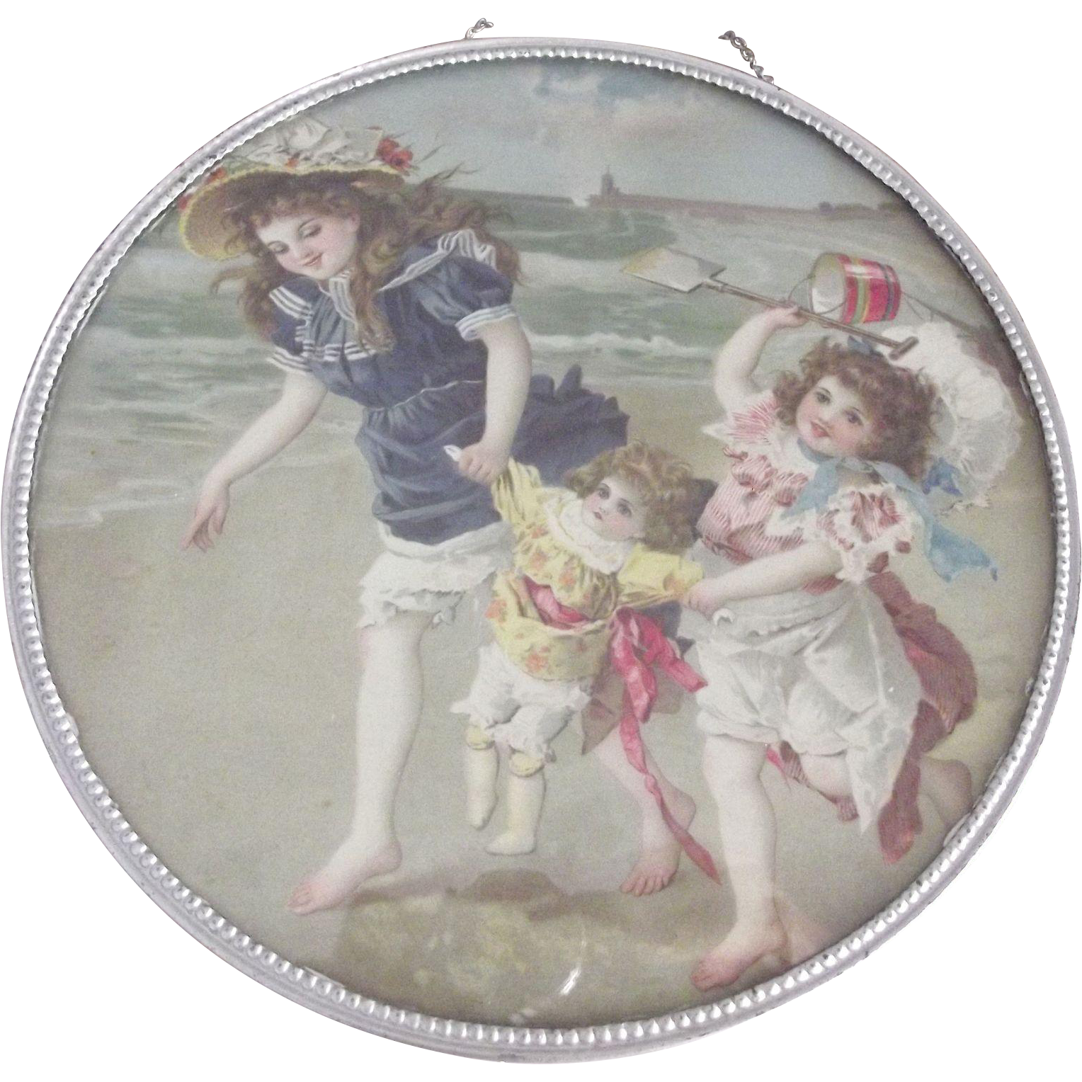 Flue Cover With Two Children and Their Doll At the Seaside