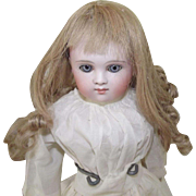 A Closed Mouth German Doll With Kid Body