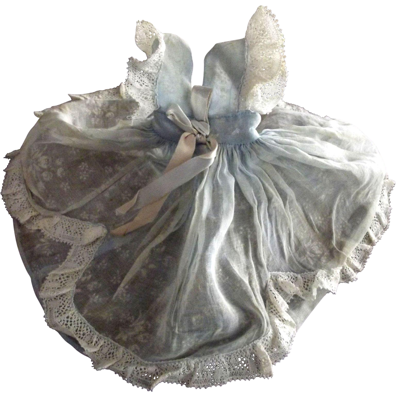 A Blue Organdy Lace Trimmed Dress