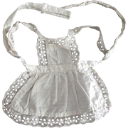 A Small Pinafore For A Doll With Eyelet Lace
