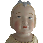 Bisque Doll With Molded Hair and Bow