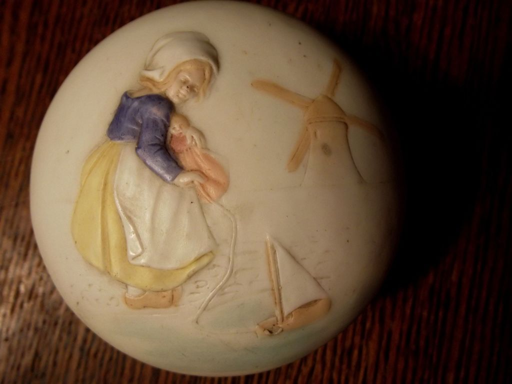 Bisque Container With Raised Design of A Dutch Girl