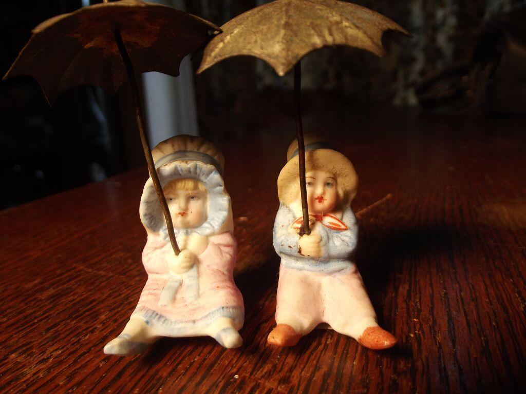Tiny Bisque Figures With Metal Umbrellas