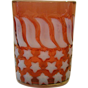Cranberry opalescent stars and stripes glass tumbler