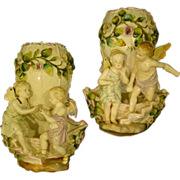 German porcelain pair of winged cupid wall pockets