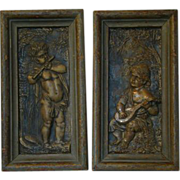 Antique pair of framed iron cupid wall plaques HOLD FOR J
