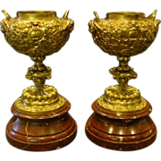 Antique French bronze and rouge marble pair mantle urns vases cupids and devils