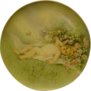 T&V Limoges hand painted porcelain plaque charger cupid in flower field roses artist signed dated 1910