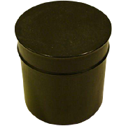 Ebony wood cylindrical covered dresser box marked