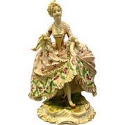 Porcelain woman in ornate dress figurine beehive mark