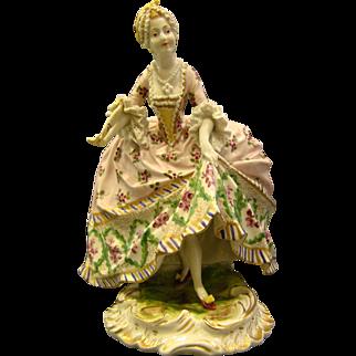 Porcelain woman in ornate dress figurine beehive mark