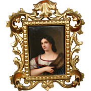 German hand painted porcelain plaque of woman in ornate frame