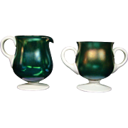 Unusual iridescent art glass teal blue and white creamer and sugar