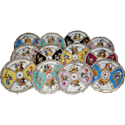 Meissen set of twelve plates courting scenes multicolored flowers