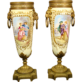 Sevres French porcelain pair hand painted urns vases courting scenes
