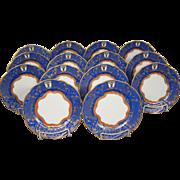 Blue gilded ornate set fourteen bread butter plates bull's head gold crown mark