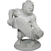 Wien Austria white porcelain monkey with accordianfigurine