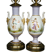 Old Paris pair hand painted porcelain lamps women face handles lilac background