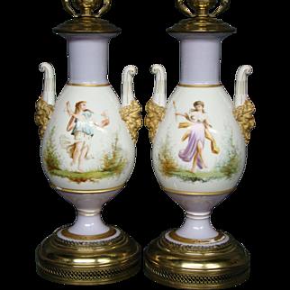 Old Paris pair hand painted porcelain lamps women face handles lilac background