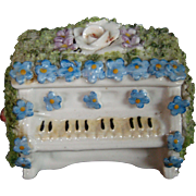German elfinware covered upright piano trinket box