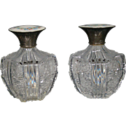 Cut glass pair perfume bottles guilloche enamel sterling silver tops